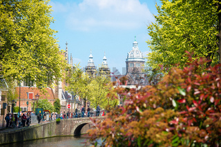 Bridge, canal and St. Nicolas Church in Amsterdam