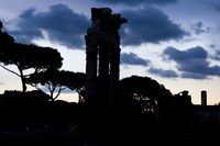 Ancient ruins of the Roman Forum in Rome at sunset
