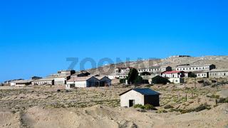 Kolmanskop ghost town sinking in sand sea, Namibia