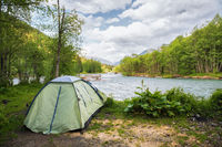 Tourist tent on the bank of a mountain river