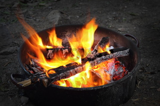 outdoor camp fire in a pot for barbeque