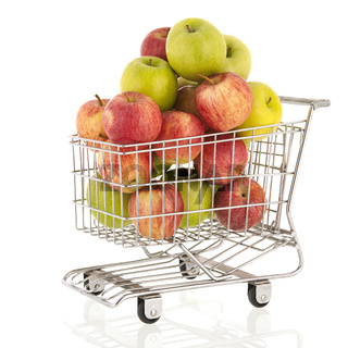 Shopping cart with green and red apples