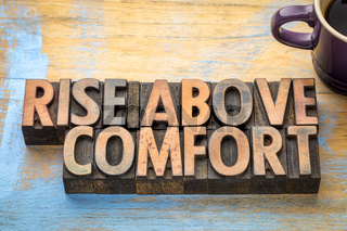 rise above comfort - word abstract in wood type