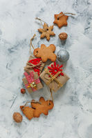 Christmas gingerbread and gifts with festive decor.