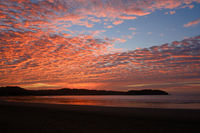 sunset sky with colorful clouds over ocean at beach -