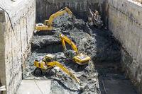 Excavators Baggers digging at a construction site