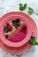 Red smoothie bowl with beets, blackberries and brown flax.