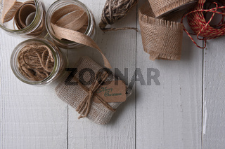 Supplies for wrapping rustic Christmas Gifts