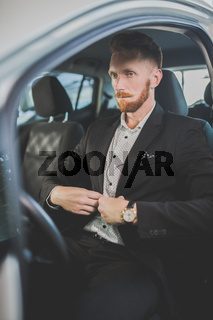 Handsome man buying new car.