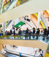 People escalator in shopping mall