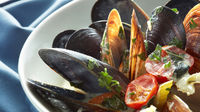 Close-up of boiled mussels with lemon