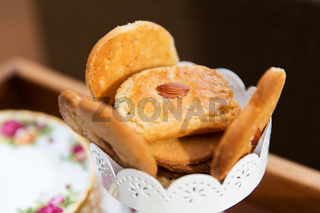 close up of almond cookies in vase