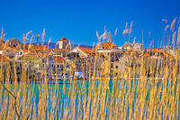 Town of Omis view through sedge on Cetina river