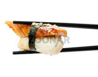Sushi with chopsticks isolated over white backgrou