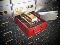 Open safe deposit box with  golden ingots. Financial banking investment concept.