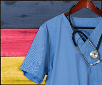 Blue scrubs with Germany flag for immigrant healthcare