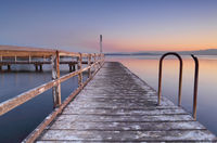 Whitewashed jetty at dusk