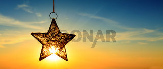 Christmas star and bright sun.