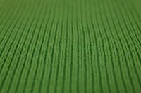 Texture of knitted green fabric macro