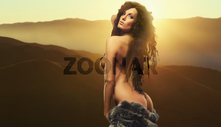 Gorgeous naked brunette posing against Tabernas Desert
