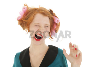Woman with curlers in hair yawning