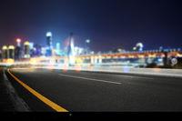 empty asphalt road with modern bridge and buildings