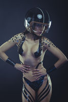Bike, woman with motorcycle helmet, naked girl dressed with black ribbons by the body. concept speed and security