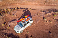 Toyota 4runner SUV with a kayak on roof on a desert trail