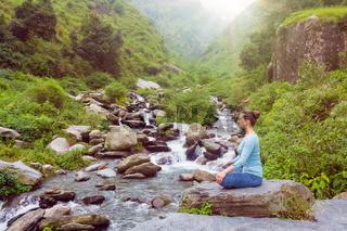 Woman in Padmasana outdoors