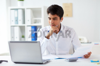 businessman in earphones working at office