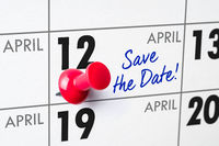 Wall calendar with a red pin - April 12