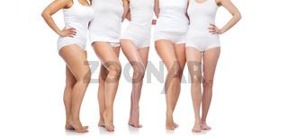 group of happy diverse women in white underwear