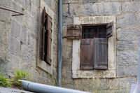 Wooden shutter, old wall