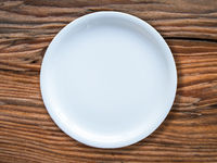 Empty White Plate On Table
