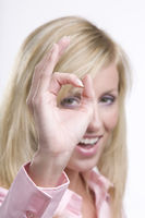 Businesswoman showing ok sign on white background