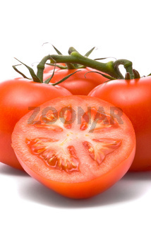 Fresh tomatoes. Macro studio isolated on white.
