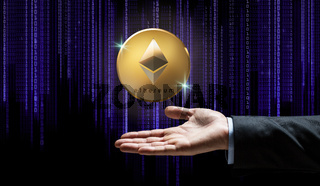businessman hand with ethereum over binary code