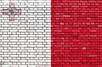 flag of Malta painted on brick wall
