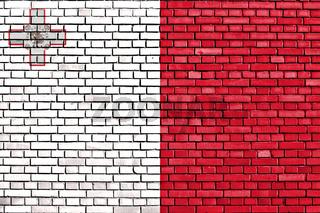 flag of Malta painted on brick wall