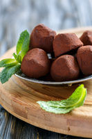 Homemade truffles made of dark chocolate.