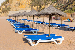 Rows of wicker parasols and beach beds