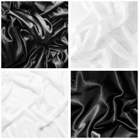 A set of textures of black and white silk. Cloth background