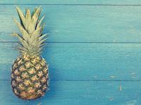 Sweet organic pineapple on blue wood
