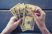 female hands counting ten dollar bills - cash money USD