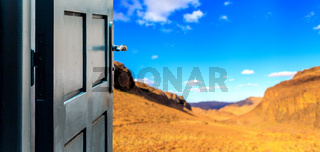 Opened door concept to colorful desert landscape