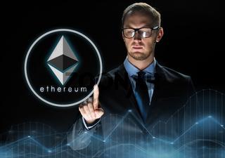 businessman with ethereum hologram over black