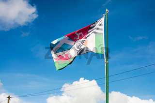 view of pan-celtic flag with blue sky in Brittany