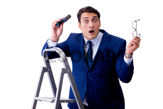 Businessman at top of ladder with binoculars