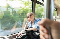 Portrait of tired woman sleeping on bus.