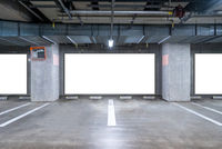 Parking garage underground with blank billboard